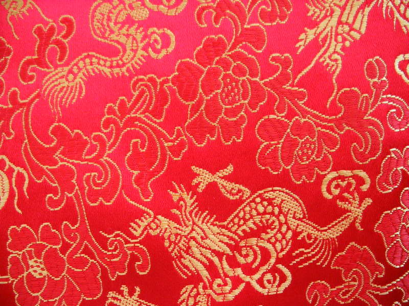 ... red background with metallic gold dragons and flowers. Code: Red 5